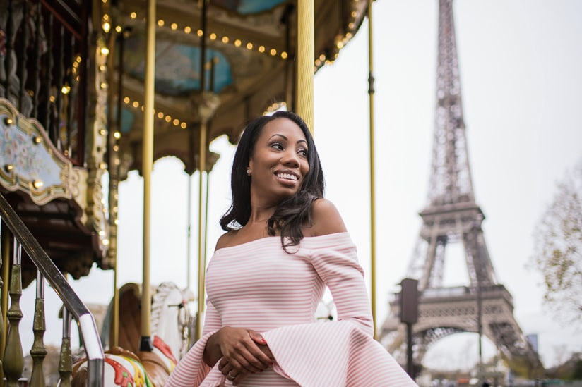 Beautiful girl posing for a Paris portrait on the merry go round near the Eiffel Tower