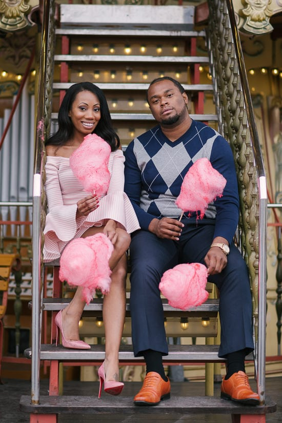 Cute black couple fun photo with cotton candy in Paris